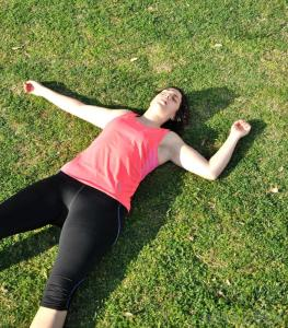 exhausted-woman-lying-on-grass